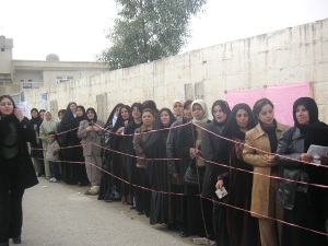 Iraq, Jan. 30, 2005: Women waiting to vote in elections.