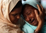 Hajj pilgrims cry as they prepare to depart for Mecca from the Tribhuvan International Airport in Kathmandu on October 18, 2011. (Navesh Chitrakar/Reute