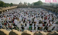 Muslims perform Eid al-Adha prayers at a mosque in the western Indian city of Ahmedabad, on November 7, 2011.