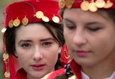 Ethnic Turkish girls from the village of Cumpana, eastern Romania, wait to perform traditional dances in Bucharest, Romania, on November 6, 2011, during celebrations of the first day of Eid al-Adha. (AP Photo/Vadim Ghirda)
