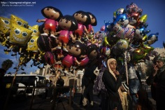 A Palestinian woman walks past balloons on sale outside the Damascus Gate leading into the old city of Jerusalem as Muslims make their way to pray in the Al-Aqsa Mosque compound, Islam's third holiest site. Nov. 6, 2011. Muslims worldwide celebrate Eid al-Adha or the Feast of the Sacrifice, marking the end of the hajj pilgrimage to Mecca and commemorating Abraham's willingness to sacrifice his son Ismail on God's command. (Menahem Kahana - AFP/Getty Images)