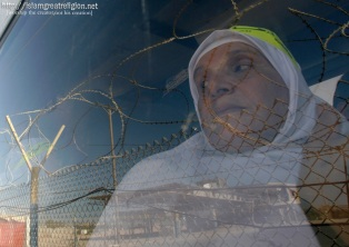 A Palestinian woman looks out of a bus carrying Muslim pilgrims on their way to the hajj in Mecca at the border between southern Gaza Strip and Egypt in Rafah on October 14, 2011. (Eyad Baba/AP) #