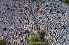 Muslim hajj pilgrims perform the noon prayers at the Nemra mosque near Mount Arafat. Nov. 5, 2011. (Fayez Nureldine - AFP/Getty Images)