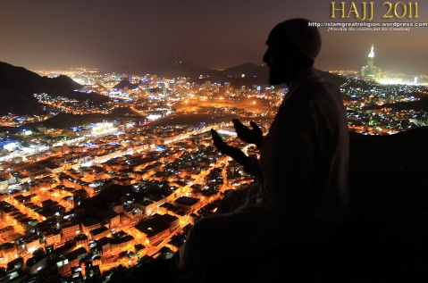 A Muslim pilgrim prays as visits the Hiraa cave at the top of Noor Mountain on the outskirts of Mecca, Saudi Arabia on November 2, 2011.