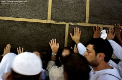 Muslim pilgrims touch the wall of the Kaaba during the circle around the Kaaba (Tawaf) at the Grand Mosque in the Saudi holy city of Mecca. Nov. 9, 2010. (Mustafa Ozer - AFP/Getty Images)
