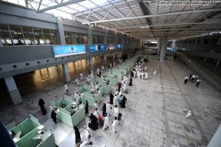 Muslim pilgrims wait in line as they arrive at Jeddah airport on October 30, 2011 before going to the Saudi holy city of Mecca, where they will take part in the annual Hajj or pilgrimage.