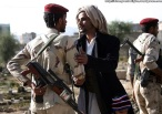 A Yemeni soldier who defected greets a fellow Muslim after attending prayers on the first day of Eid al-Adha prayers in Sanaa on November 6, 2011. (Mohammed Huwais/AFP/Getty Images)