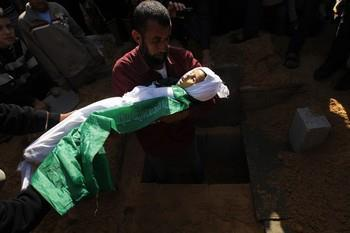 Nic6155248</p> <p>A Palestinian man barries the body of Tamer Abu Sefan, three and a half years old, during a funeral in the village of Beit Lahia, in the northern Gaza Strip on November 18, 2012. A ground invasion of the Gaza Strip would lose Israel much international sympathy and support, British Foreign Secretary William Hague warned. AFP PHOTO/MOHAMMED ABED (Photo credit should read MOHAMMED ABED/AFP/Getty Images) 2012 AFP