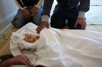 """Nic6155207</p> <p>Palestinian mourners bid farewell to 18-month-old Eyad Abu Khosa, killed in the latest Israeli airstrikes, during his funeral in the Bureij refugee camp in central Gaza Strip on November 18, 2012. Israeli Prime Minister Benjamin Netanyahu said that Israel is ready to """"significantly expand"""" its operation against militants in the Hamas-run Gaza Strip as it entered its fifth day. AFP PHOTO/MAHMUD HAMS (Photo credit should read MAHMUD HAMS/AFP/Getty Images) 2012 AFP"""