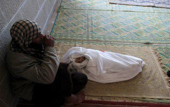 """156652694</p> <p>Palestinian man mourns next to the body of 18-month-old Eyad Abu Khosa, killed in the latest Israeli airstrikes, during his funeral in the Bureij refugee camp in central Gaza Strip on November 18, 2012. Israeli Prime Minister Benjamin Netanyahu said that Israel is ready to """"significantly expand"""" its operation against militants in the Hamas-run Gaza Strip as it entered its fifth day. AFP PHOTO/MAHMUD HAMS (Photo credit should read MAHMUD HAMS/AFP/Getty Images) 2012 AFP"""