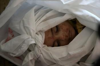 "Nic6155196</p> <p>The body of 18-month-old Palestinian boy Eyad Abu Khosa, killed in the latest Israeli airstrikes, lays on the floor during his funeral in the Bureij refugee camp in central Gaza Strip on November 18, 2012. Israeli Prime Minister Benjamin Netanyahu said that Israel is ready to ""significantly expand"" its operation against militants in the Hamas-run Gaza Strip as it entered its fifth day. AFP PHOTO/MAHMUD HAMS (Photo credit should read MAHMUD HAMS/AFP/Getty Images) 2012 AFP"