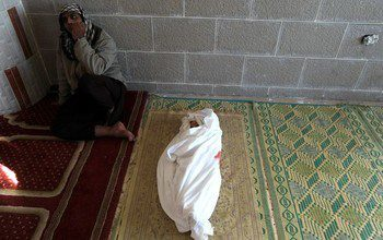 """156652690</p> <p>Palestinian man mourns next to the body of 18-month-old Eyad Abu Khosa, killed in the latest Israeli airstrikes, during his funeral in the Bureij refugee camp in central Gaza Strip on November 18, 2012. Israeli Prime Minister Benjamin Netanyahu said that Israel is ready to """"significantly expand"""" its operation against militants in the Hamas-run Gaza Strip as it entered its fifth day. AFP PHOTO/MAHMUD HAMS"""