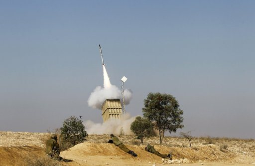 Israeli soldiers watch as an Iron Dome launcher fires an interceptor rocket near the southern city of Beersheba November 15, 2012. Hamas fired dozens of rockets into southern Israel on Thursday, killing three people, and Israel launched numerous air strikes across the Gaza Strip, threatening a wider offensive to halt repeated Palestinian salvoes. REUTERS/Baz Ratner