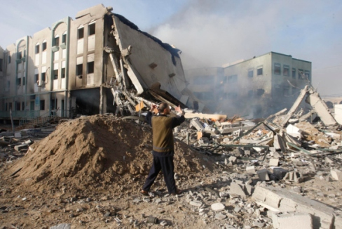 Nov 16, 2012 Aftermath of Israeli airstrikes on the Civil Administration building – Gaza  | Photo by WAFA