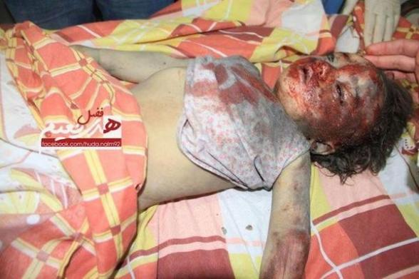 Palestinian child Ibrahim Al-Dalou pulled out of the rubble in Gaza via @gazapl Nov 18, 2012