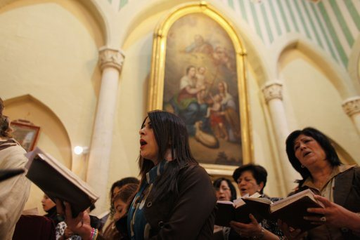 Palestinian Christians take part in a prayer to show solidarity with Gaza, at a Catholic church in the West Bank town of Beit Jala near Bethlehem November 18, 2012. Israel bombed Palestinian militant targets in the Gaza Strip from air and sea for a fifth straight day on Sunday, preparing for a possible ground invasion while also spelling out its conditions for a truce. REUTERS/Ammar Awad