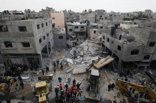 Palestinians gather at the site of an Israeli air raid in Gaza City on November 17, 2012. Israeli raids killed three children and critically wounded two more in Gaza early Sunday even as the army said there had been no rocket fire all night amid growing talk of a truce Photo by AFP
