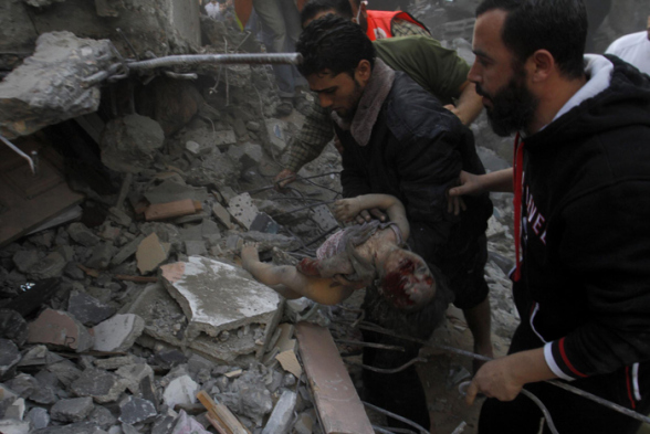 PHOTO   Children slayed by #Israel covered with rubble of bombed homes in Gaza Nov 18, 2012 Photo by Wafa
