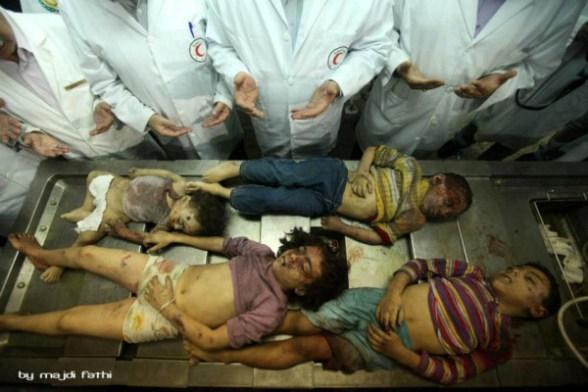 Doctors in the hospital making du'a for the dead children.<br /><br /><br /><br /><br /><br /> Nov 2012 Gaza Under Attack Photo by Marah El Wadia