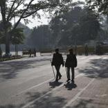Police officers patrol a closed road leading to the India Gate in New Delhi December 29, 2012. An Indian woman whose gang rape in New Delhi triggered violent protests died of her injuries on Saturday in a Singapore hospital, bringing a security lockdown in Delhi and recognition from India's prime minister that social change is needed. The India Gate has been the epicenter of previous related protests. REUTERS/Ahmad Masood (INDIA - Tags: CIVIL UNREST CRIME LAW)