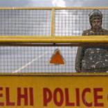 A policeman stands guard at a barricade to stop protesters, near India Gate in New Delhi December 29, 2012. The Indian gang rape victim whose assault in New Delhi triggered nationwide protests died of her injuries on Saturday in a Singapore hospital, potentially threatening fresh protests in India where her case is a rallying point for women's rights. REUTERS/Adnan Abidi (INDIA - Tags: CRIME LAW CIVIL UNREST)