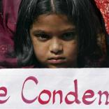 A girl holds a placard as she takes part in a protest rally in the southern Indian city of Hyderabad December 29, 2012. A woman whose gang rape sparked protests and a national debate about violence against women in India died of her injuries on Saturday, prompting a security lockdown in New Delhi and an acknowledgement from India's prime minister that social change is needed. REUTERS/Krishnendu Halder (INDIA - Tags: CRIME LAW CIVIL UNREST)