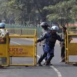 A member of the Rapid Action Force (RAF) pulls a barricade to close a road leading to the India Gate in New Delhi December 29, 2012. An Indian woman whose gang rape in New Delhi triggered violent protests died of her injuries on Saturday in a Singapore hospital, bringing a security lockdown in Delhi and recognition from India's prime minister that social change is needed. The India Gate has been the epicenter of previous related protests. REUTERS/Danish Siddiqui (INDIA - Tags: CIVIL UNREST CRIME LAW)