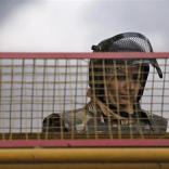 A policewoman stands guard at a barricade to stop protesters, near India Gate in New Delhi December 29, 2012. The Indian gang rape victim whose assault in New Delhi triggered nationwide protests died of her injuries on Saturday in a Singapore hospital, potentially threatening fresh protests in India where her case is a rallying point for women's rights. REUTERS/Adnan Abidi (INDIA - Tags: CRIME LAW CIVIL UNREST TPX IMAGES OF THE DAY)