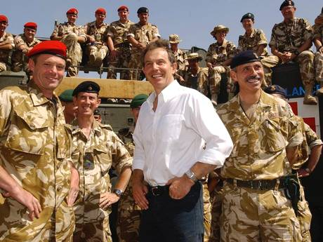 "Tony Blair meets troops in Iraq in 2003. A dossier alleging ""systematic"" war crimes by British forces - sent to Iraq by the former Prime Minister - has been presented to the International Criminal Court (PA)"