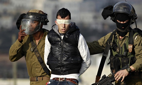 Israeli soldiers arrest a Palestinian after clashes at a protest against a Jewish settlement in the West Bank near Ramallah, January 2014. Photograph: Mohamad Torokman/Reuters