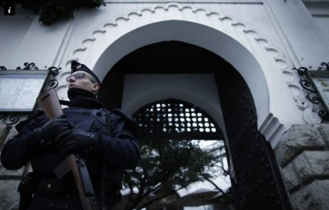 Police standing in front of mosque