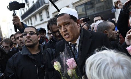 Hassen Chalghoumi, Drancy mosque's imam, in Paris on Thursday paying tribute to the staff of Charlie Hebdo magazine. Photograph: Martin Bureau/AFP/Getty Images