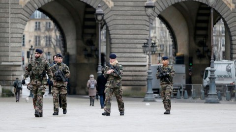"French soldiers patrol near the Louvre Museum in Paris as part of the highest level of ""Vigipirate"" security plan, the day after a shooting at the Paris offices of Charlie Hebdo"