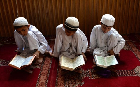 Afghan children study the Koran during first day of the month of Ramadan at a mosque in Jalalabad