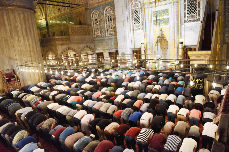 Muslims pray at the Sultanahmet Mosque, also known as the ...