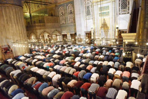 Muslims pray at the Sultanahmet Mosque, also known as the Blue Mosque, in Istanbul, Turkey