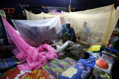 Rohingya Muslims migrants sleep using mosquito nets during the first day of the fasting month of Ramadhan, at a refugee camp in Bireun Bayeun, East Aceh, Aceh, Indonesia...