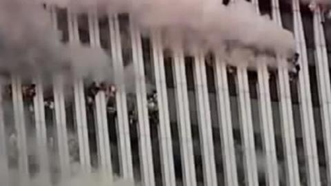 Workers trapped inside the Twin Towers hang out of windows gasping for air