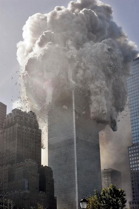 THEN--The north tower of New York's World Trade Center collapses after being struck by hijacked American Airlines Flt. 11, Tuesday, Sept. 11, 2001. (AP Photo Richard Drew)